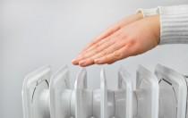 Hands warming over a radiator Shutt